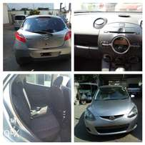 mazda demio 1300CC grey kcn... with all extras offer price 600k