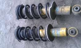 Shock absorbers and coil springs