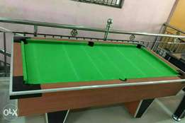 Local snooker board with cue sticks and balls