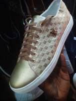 Gold sneakers shoe
