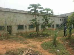 Big Warehouse On 2Acres of Land with Offices at Lusada Rd Agbara.CofO