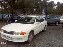Mitsubishi lancer, very clean, accident free. 1600cc, fully loaded..