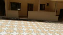 An executive chamber and hall apartment at POKUASI. 1 year adance.