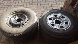 Tyres - Continetal & Goodyear - 215-16 . with Rims.