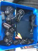 Collectors Item. Sony Playstation 2 + 21 Games