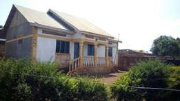 3 bedroom house seated on 15 decimals in Kireka kasokoso at 65m