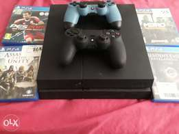 PS4 1TB 2 Remotes plus 4 games for sale