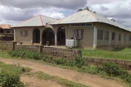 10 bedroom building with a plot open field