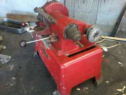 Valve refacing machine