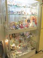 Large glass display cabinet with lights and 4 sliding doors- COLLECT