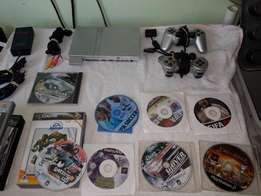 Playstation 2 with all cables accessories and lots of games Plus