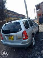 Mazda Tribute with its original Paint ,petrol at Thika .
