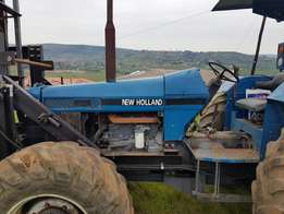 New Holland 6640 4x4 Tractor with drill rig.