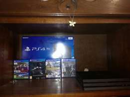 New ps4 pro 1tb 4 months old with cash and warranty slip for sale