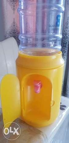 Water dispenser for kids with a bottle