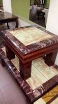 Marble centre table with side stools.