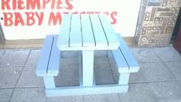 Small grey wooden bench + table.