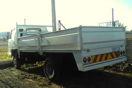 a isuzu 4,8 and 12 tonne drop sides for sale