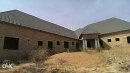 Uncompleted guest house with 10self contained rooms,