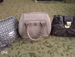 three used handbags