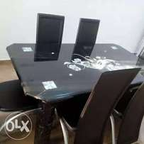Six sitter glass dining table set