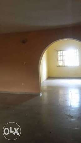 Standard and spacious 300k with 3t at igando facing a tarred rd Ikotun - image 2