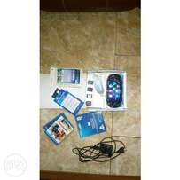 PS Vita with 4 game cards