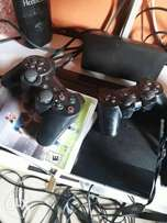 Neat Ps3 with Five games.. fifa15 fifa16 GOd of war nd more
