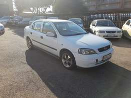 Opel Astra. Low Price.. white in colour. in good condition.