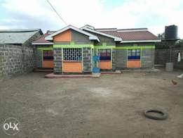 Plot for sale with a complete 2 bedroom house and servents quarters