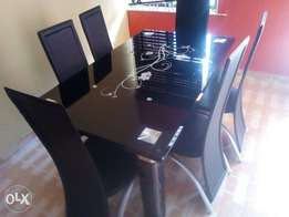 Classy 6 sitter glass dining table