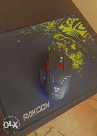 Medium mouse pad and mouse in very gd condition barely used