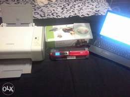 Samsung laptop with faulty screen+photocopy machine +portable Scanner