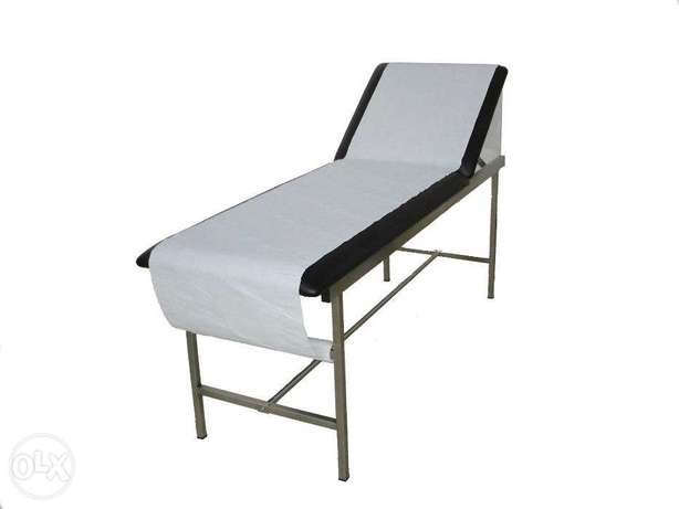 Examination couch with paper roll holder