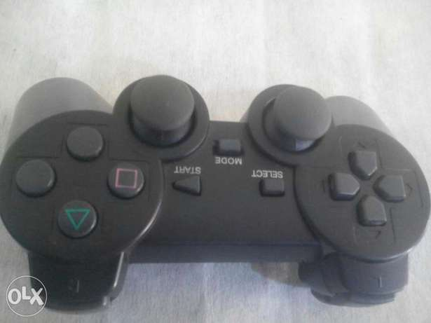 Ps 2 game with wireless pad for sale on Osogbo - image 2