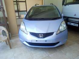 Honda fit sky blue with alloy rims and roof rails fully fully loaded