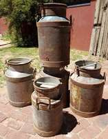 Variety of Large Milk Cans