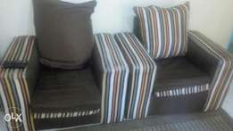An used Five sitter sofa sett for sale.