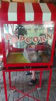 Large industrial popcorn machine on trolley stand