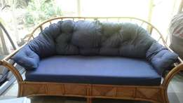 Comfortable Cane suite-1 two seater and 2 single chairs