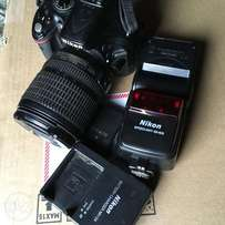 Used Nikon D5200 with 2batteries, lens and Nikon speedlight.