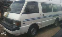 A neatly used Mazda (18 seater) Bus