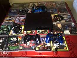 Ps3 console +steering wheel+ move kit+30 games