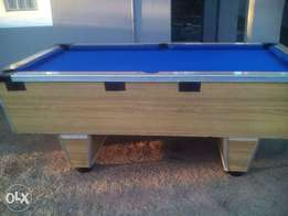 Coin operated, slate top pool table