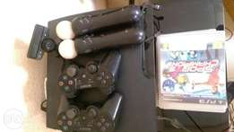 Sony PlayStation 3 160GB with move controllers, camera and 14 games