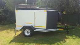Camping trailer with roof top tent