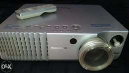 Panasonic PTAE700E High Definition Projector and Screen