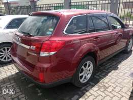 Subaru Outback redwine KCN number 2010 model loaded with alloy rims