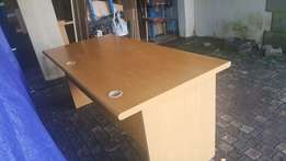 Oak desk with drawers.