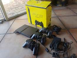 PS2 Console with 2 controllers and games